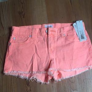 Bright orange shorts. Hudson size 25